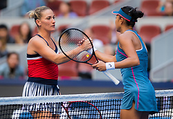 October 3, 2018 - Timea Babos of Hungary & Shuai Zhang of China at the net after their second-round match at the 2018 China Open WTA Premier Mandatory tennis tournament (Credit Image: © AFP7 via ZUMA Wire)