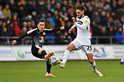 Liam Kelly (38) of Reading tackles Matt Grimes (21) of Swansea City during the EFL Sky Bet Championship match between Swansea City and Reading at the Liberty Stadium, Swansea, Wales on 27 October 2018.