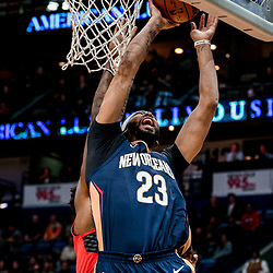 Jan 12, 2018; New Orleans, LA, USA; New Orleans Pelicans forward Anthony Davis (23) dunks over Portland Trail Blazers forward Al-Farouq Aminu (8) during the first quarter at the Smoothie King Center. Mandatory Credit: Derick E. Hingle-USA TODAY Sports