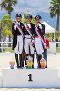 Podium Juniors Freestyle 1. Hannah Erbe - Carlos, 2. Semmieke Rothenberger - Dissertation, 3. Febe van Zwambagt - FS Las Vegas<br /> European Championships Dressage 2016<br /> © DigiShots