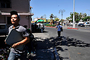 A young man rushes through the streets in Nogales, Sonora, Mexico, near the customs inspection station across the border at Nogales, Arizona, USA.
