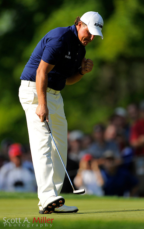 Aug 14, 2009; Chaska, MN, USA; Phil Mickelson (USA) reacts to a made putt during the second round of the 2009 PGA Championship at Hazeltine National Golf Club.  ©2009 Scott A. Miller