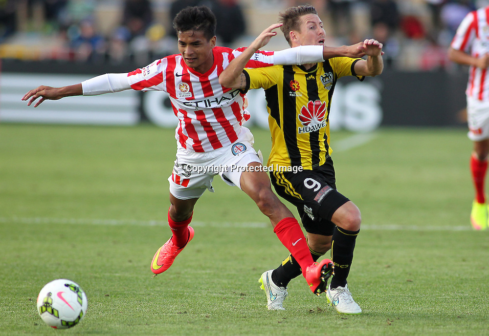 Phoenix' Nathan Burns is tripped by Melbournes' Safuwan Baharudin during the A-League football match between the Wellington Phoenix & Melbourne City, at the Hutt Recreational Ground, Wellington, 14 February 2015. Photo.: Grant Down / www.photosport.co.nz