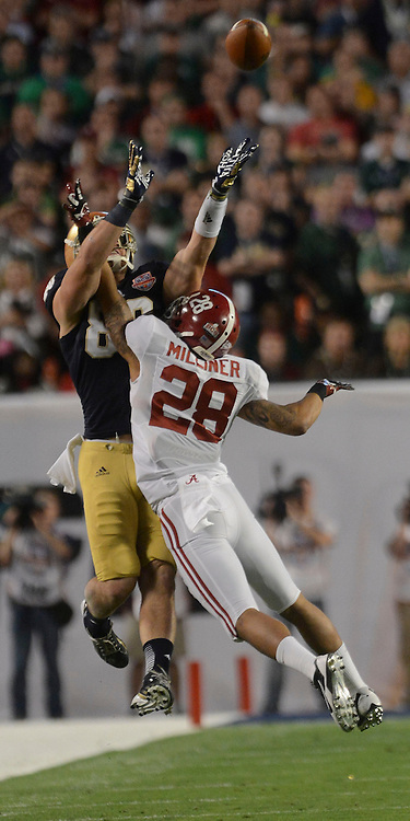 Daily Photo by Gary Cosby Jr.   Notre Dame tight end Tyler Eifert leaps for a pass against Alabama defensive back Dee Milliner (28) during the first half of the BCS National Championship Game in Sun Life Stadium Monday, January 7, 2013.