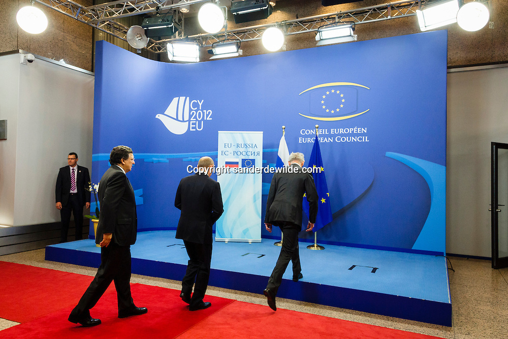 Russian President Vladimir Putin is welcomed by European Council President Herman Van Rompuy (R) ahead of an European Union-Russia summit in Brussels December 21, 2012. from left to right: J.M Barroso, Putin and Herman van Rompuy walk up on the press stage.