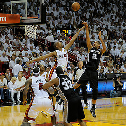 Jun 18, 2013; Miami, FL, USA; San Antonio Spurs power forward Tim Duncan (21) shoots against Miami Heat center Chris Bosh (1) during the second quarter of game six in the 2013 NBA Finals at American Airlines Arena.  Mandatory Credit: Derick E. Hingle-USA TODAY Sports