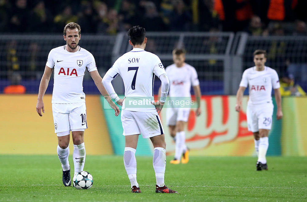 Tottenham Hotspur's Harry Kane (left) and Tottenham Hotspur's Son Heung-Min (7) appear dejected after Borussia Dortmund's Pierre-Emerick Aubameyang (not in picture) scores his side's first goal of the game