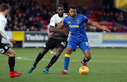 Anthony Grant of Peterborough United in action with Tom Soares of AFC Wimbledon - Mandatory by-line: Joe Dent/JMP - 12/11/2017 - FOOTBALL - Cherry Red Records Stadium - Kingston upon Thames, England - AFC Wimbledon v Peterborough United - Sky Bet League One