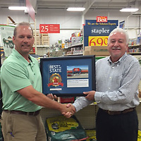 (Courtesy Photo)<br /> Nabors Home Center was named an All-Star by Hardware + Building Supply Dealer. Lee Nabors, on left, of Nabors Home Center is shown receiving a plaque from Do it Best Corp. Territory Manager Roy Jones.