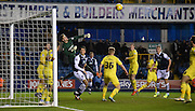 Benjamin Buchel punches clear the danger during the Johnstone's Paint Trophy semi final first leg match between Millwall and Oxford United at The Den, London, England on 14 January 2016. Photo by Michael Hulf.