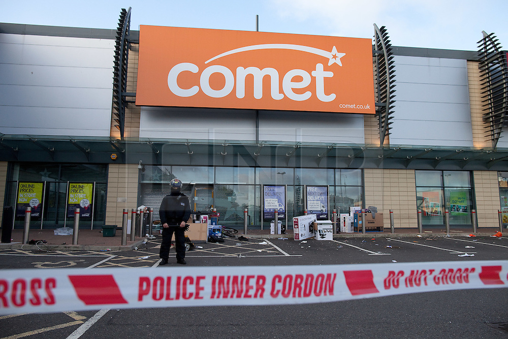 © Licensed to London News Pictures . 07/08/2011 . London , UK . Destruction and looting inside Comet at Tottenham Hale Retail Park . Riots spread from Tottenham High Road when looters raided televisions , cameras and other expensive products . Overnight rioting and looting in Tottenham , following a protest against the police shooting of Mark Duggan . Photo credit : Joel Goodman/LNP