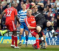 Photo: Ed Godden/Sportsbeat Images.<br />Reading v Liverpool. The Barclays Premiership. 07/04/2007. Liverpool's Sami Hypia colides with Reading keeper Marcus Hahnemann.