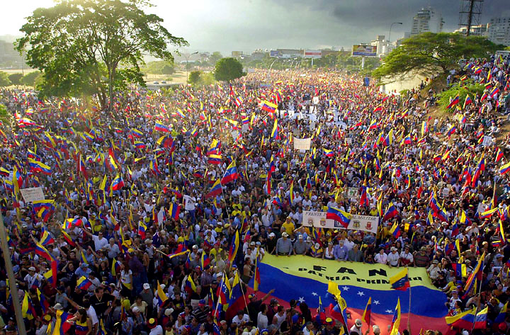 The clouds part on thousands of demonstrators on the highwayss of Caracas, Venezuela,  Dec. 14, 2002, calling for the resignation of President Hugo Chavez. Venezuela is in the midst of a  nation wide strike that has left businesses closed and food and gas in short supply.