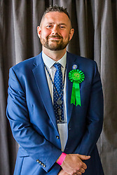 © Licensed to London News Pictures. 03/05/2019. Brighton, UK. Leader of the Brighton and Hove Green Party, PHELIM MAC CAFFERTY is re-elected to the Brighton and Hove Council the day after the 2019 local elections. Photo credit: Hugo Michiels/LNP