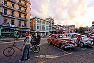Cars and bicitaxi in front of the Capitolio at sunset, Havana Centro, Cuba.