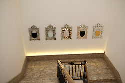 ORLAN<br /> Mirror-portraits-stress of our society<br /> 2009<br />  5 venetian mirrors, glass vessels, oil, water from Venice, sequins, blood, gold<br /> 87 x 57 x 2 cm ( cad.)<br /> Courtesy Venice Projects.