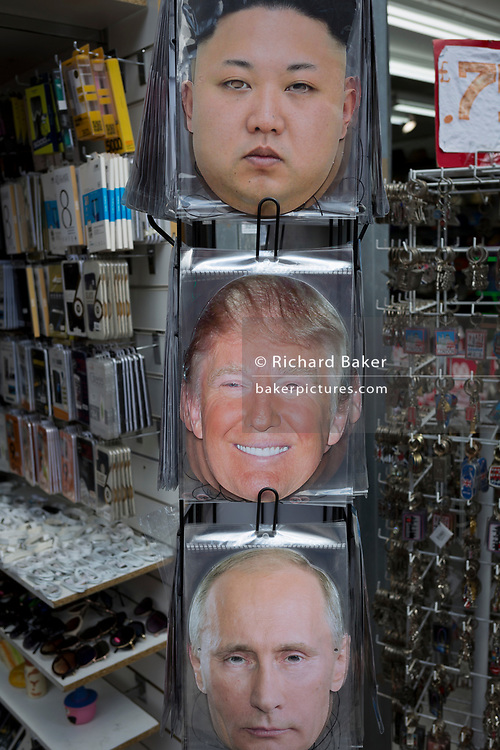 The faces of North Korean leader Kim Jong-un, a smiling US President Donald Trump and Russian President Vladimir Putin appear on face masks outside a tourist trinket retailer on Oxford Street, on 1st May, in London, England.