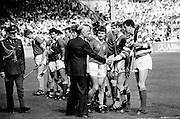 In the senior hurling final, Cork emerged victorious over a much-fancied Galway team, with a score of 4-13 to Galway's 2-15. The team are introduced to President Dr Patrick Hillery by Cork captain Liam Cashman.<br />