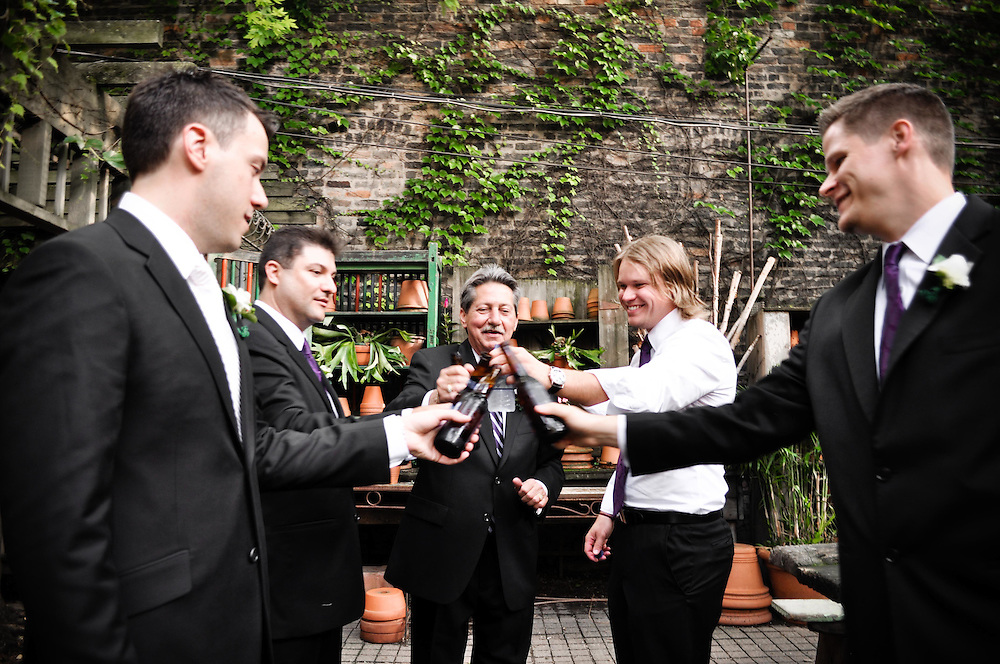 Mike and his guys cheers  in the courtyard just before Mike & Kelly's ceremony took place at A New Leaf, Chicago, IL