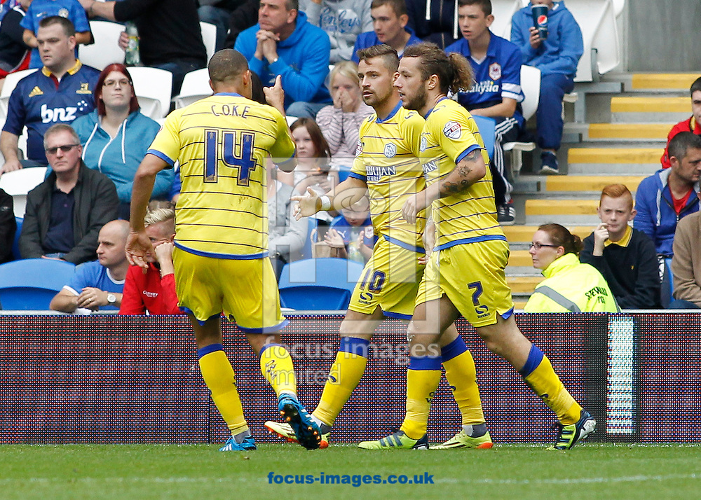 Stevie May (R) celebrates the first goal for Sheffield Wednesday during the Sky Bet Championship match at the Cardiff City Stadium, Cardiff<br /> Picture by Mike  Griffiths/Focus Images Ltd +44 7766 223933<br /> 27/09/2014