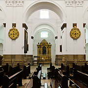 Pews inside the Catedral Metropolitana in the center of Guatemala City, Guatemala