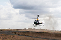 South African National Parks Helicopter taking off, Kruger National Park, Limpopo, South Africa