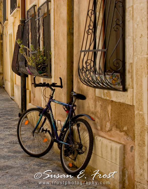 Bicycle on street in Otygia, Italy.