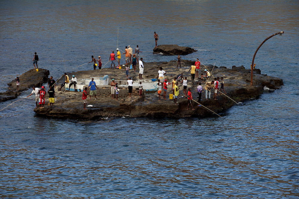 In Furna people gather on the top of a rock fishing. Furna is the village where is located the only harbour that serves the island when sea conditions allows ships to navigate.