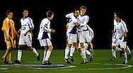 9 NOV. 2010 -- ST. LOUIS -- St. Louis University High School soccer player Ryan Merrifield (21, center right) celebrates with his SLUH teammates after scoring the second goal of the Jr. Bill's game against Christian Brothers College High School during the MSHSAA Class 3 Sectionals at SLUH Tuesday, Nov. 9, 2010. The Jr. Bills won, 2-1, on a pair of first half goals by Merrifield. SLUH will take on Jackson High School Saturday, Nov. 13 at Jackson. Image © copyright 2010 Sid Hastings.