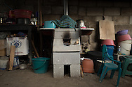 This stove is used by the family to cook their food. The eat most tortillas and beans. The tortillas are made fresh in the morning.