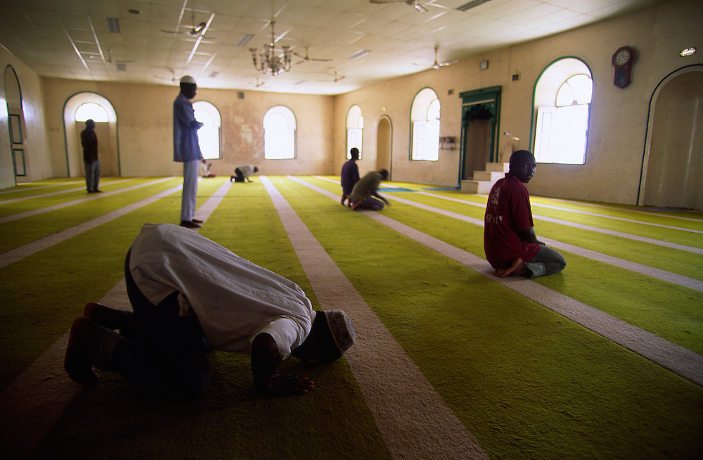 Men praying in the Great Mosque in Ilha de Mozambique