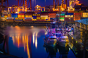 Fishing boats at night across from the shipping container loading area of the Port of Vancouver.<br />  <br /> f 16 @ 4 s, 400 ISO<br /> 28.0-300.0 mm f/3.5-5.6 at 92 mm on NIKON D850
