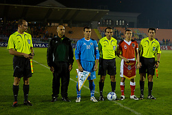 San Marino, San Marino - Wednesday, October 17, 2007: Wales' captain Craig Bellamy and San Marino's captain Andy Selva line-up with referee Anthony Zammit and assistants Philip Agius (R) and Ingmar Spiteri from Malta during the Group D UEFA Euro 2008 Qualifying match at the Serravalle Stadium. (Photo by David Rawcliffe/Propaganda)