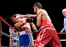 Amir Khan lands a right during the WBA and WBO Inter-Continental Lightweight title fight between Amir Khan and Marc Antonio Barrera at the MEN Arena on March 14, 2009 in Manchester, England.