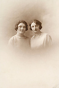 two sisters in an old vintage photograph