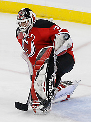 Apr 23, 2009; Newark, NJ, USA; New Jersey Devils goalie Martin Brodeur (30) makes a glove save during the first period of game five of the eastern conference quarterfinals of the 2009 Stanley Cup playoffs at the Prudential Center.