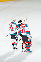 KELOWNA, CANADA - FEBRUARY 14: Joe Gatenby #28 congratulates Jake Morrissey #31 of Kelowna Rockets on the win and shut out against the Moose Jaw Warriors on February 14, 2015 at Prospera Place in Kelowna, British Columbia, Canada.  (Photo by Marissa Baecker/Shoot the Breeze)  *** Local Caption *** Joe Gatenby; Jake Morrissey;