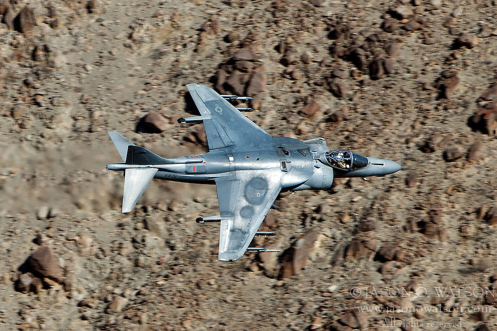 McDonnell Douglas AV-8B+ Harrier II DD-08 of the US Navy's VX-31 Dust Devils squadron flies low level through the Star Wars Canyon, Jedi Transition, Sidewinder course, Death Valley National Park, California, United States of America