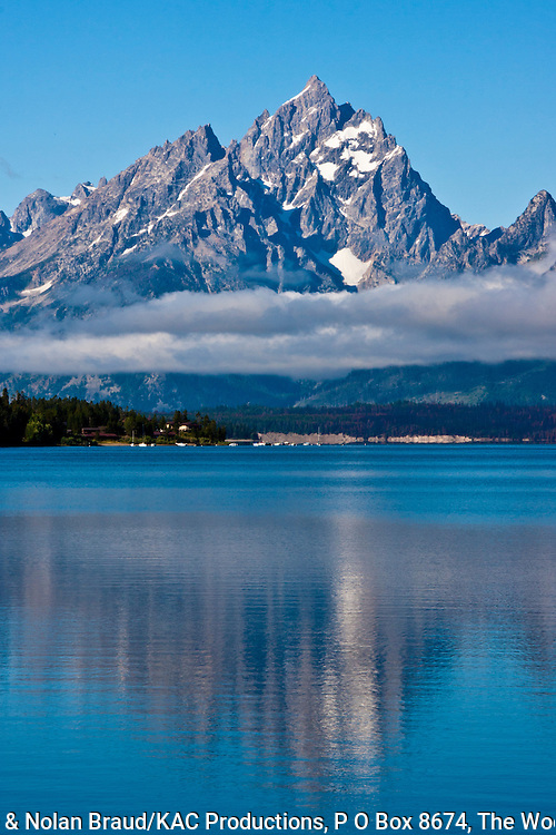 Early morning light on the Grand Tetons Mountain Range and Jackson Lake in the Grand Tetons National Park in Wyoming. The Tetons are the youngest range in the Rocky Mountains and icy, glaciered peaks are among the most photographed vistas in the world.
