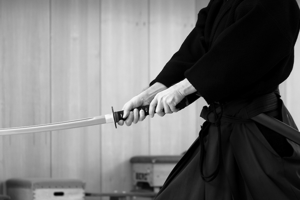 Detail of a iaido practicioner finishing a two-handed cut