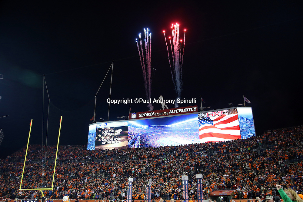 Fireworks explode above the scoreboard during pregame ceremonies and the playing of the National Anthem before the Denver Broncos 2015 NFL week 16 regular season football game against the Cincinnati Bengals on Monday, Dec. 28, 2015 in Denver. The Broncos won the game in overtime 20-17. (©Paul Anthony Spinelli)
