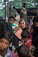 Newly arrived Rohingya Muslims from Myanmar wait to complete the registration process at Kutupalong refugee camp in Bangladesh. They are among the 600,000 Rohingya who fled Myanmar in the two months since August 25. (October 29, 2017)