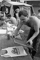 Community arts workers silkscreening  clothing with support slogans. Cortonwood Gala Day. Brampton Brierlow 25/08/1984.