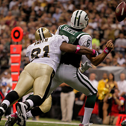2009 October 04: New Orleans Saints defensive end Will Smith (91) hits New York Jets quarterback Mark Sanchez (6) in the endzone causing a fumble that was recovered by the Saints for a touchdown during the first half of a week four regular season game between the New Orleans Saints and the New York Jets at the Louisiana Superdome in New Orleans, Louisiana.