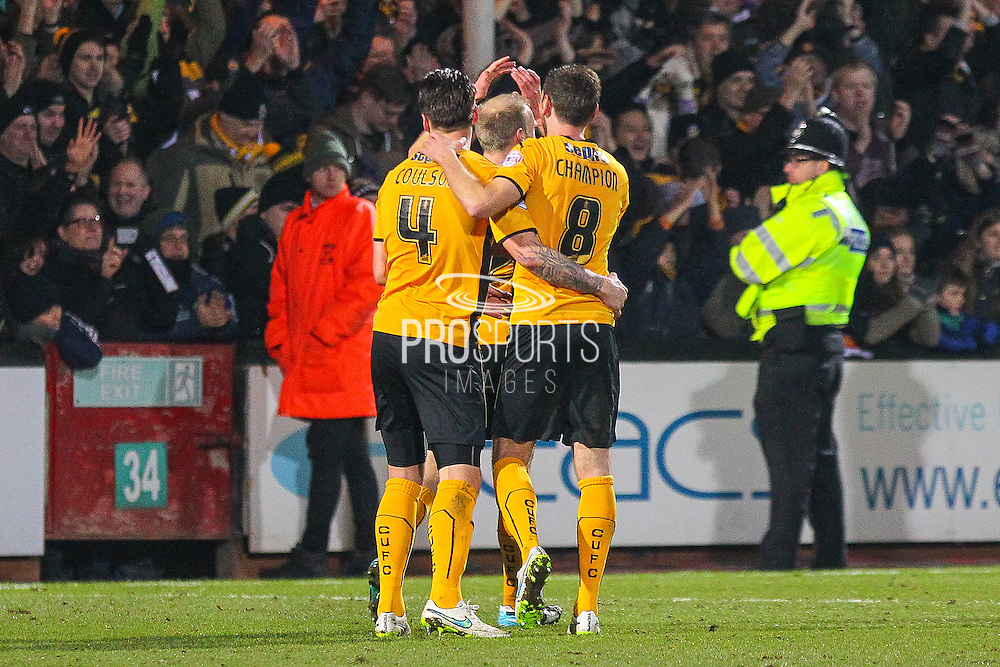 Cambridge United Josh Coulson and Cambridge United Tom Champion celebrate the 0-0 draw the The FA Cup match between Cambridge United and Manchester United at the R Costings Abbey Stadium, Cambridge, England on 23 January 2015. Photo by Phil Duncan.