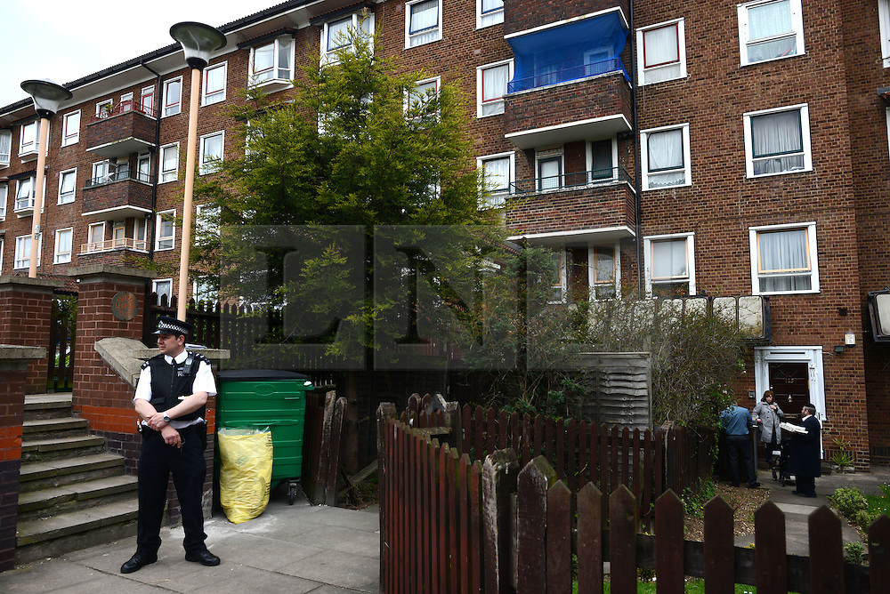 © Licensed to London News Pictures. 05/05/2013. London, UK. A police man stands in front of the scene where a 30 year-old man was stabbed to death at a flat in Jessam Avenue, Clapton, east London, on Saturday night.Two men have been arrested on suspicion of murder. Photo credit : Peter Kollanyi/LNP