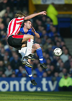 Photo. Aidan Ellis<br />Everton v Southampton. FA Barclaycard Premiership 22/02/03.<br />Everton David Unsworth and Southampton James Beattie<br />.