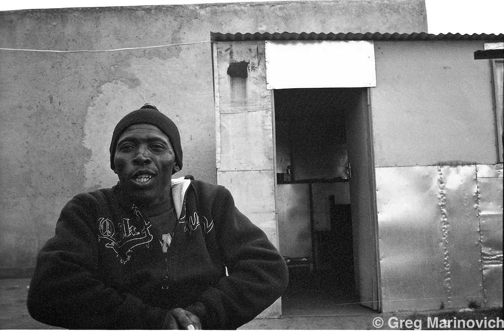 Thokoza, 2009. South Africa. Merchant Bonkosi Mazibuko, former commander of Slovo section Self Defence Unit. Paralysed by a bullet in his spine, while robbing a shop after 1994. Photo Greg Marinovich