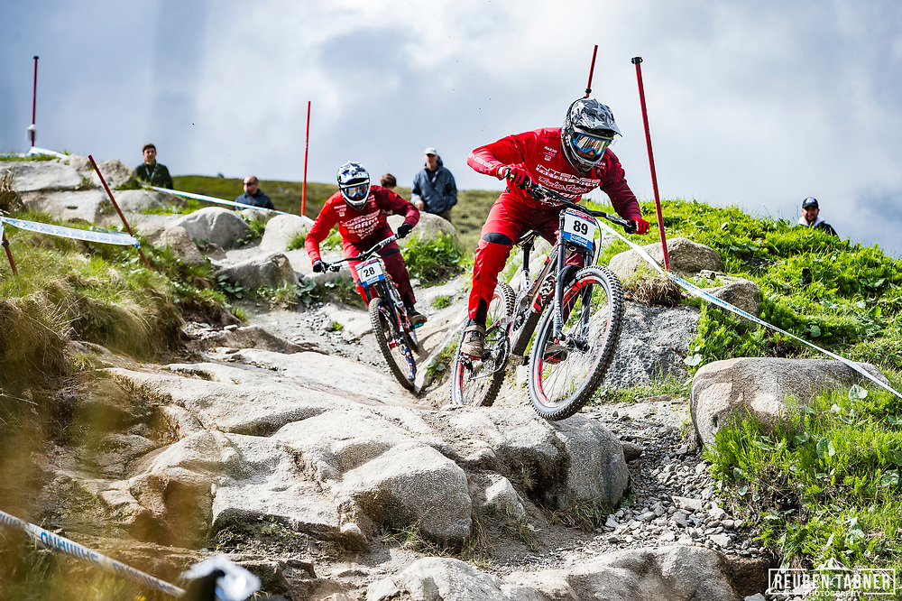 Dean Lucas (89) and Charlie Harrison (28) of Intense Factory Racing during Sunday practise at the UCI Mountain Bike World Cup in Fort William.