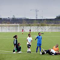 Nederland, Amsterdam , 25 augustus 2010..Training van de mini's van Zuidoost United op het sportcomplex van Nieuwe Bijlmerpark.Training of the younger ones (minis) in the Southeast United  of the New Bijlmerpark in Amsterdam South-East.